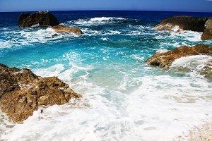 Sea Waves Breaking on Rocks