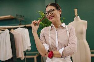 Female dressmaker standing