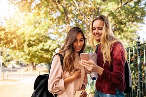 Female students using cellphone