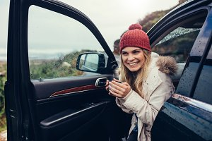 Beautiful smiling woman in her car