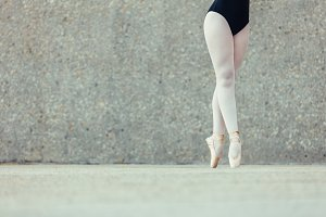 Closeup of legs of ballet dancer