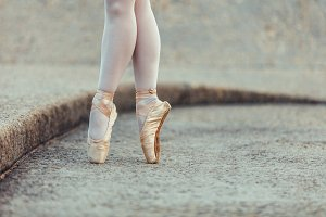 Close up of legs of ballet dancer