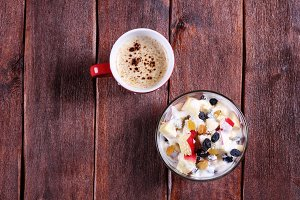 Fruit salad and cappuccino