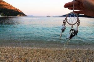 Hand Holding Dream Catcher, Beach