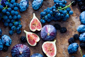 Fresh organic figs, grapes, prunes