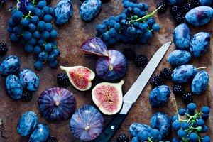 Fresh organic figs, grapes, prunes