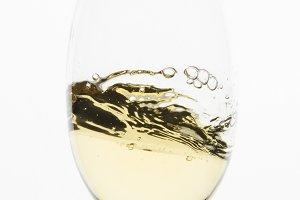 Close up white wine swirl - square