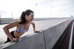 Fit woman doing push ups