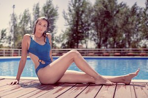 one young woman, summer pool sunny