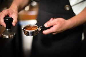 Coffee being prepared by staff
