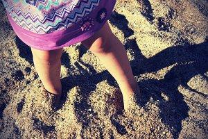 Kid feet in sand