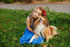 Little girl with a dog Sheltie
