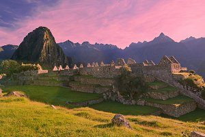 Pink sunrise light over machu picchu