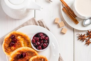 Cottage cheese pancakes with cherry sauce