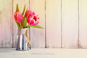 Pink tulips in metal pitcher