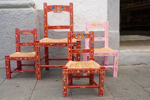 Aged colored ornamental wooden chair