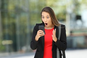 Astonished executive with phone