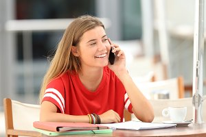 Happy student talking on phone