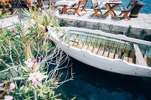 Rustic vintage boat in flowers