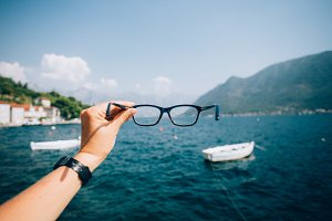 View on sea and mountains in glasses