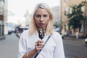 Young pretty woman eats icecream