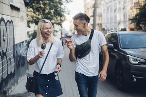 Couple walks city and laughs