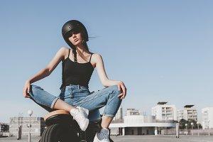 Girl sitting on motorcycle