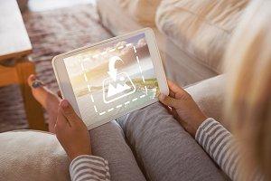 Woman Using Tablet On Sofa Mockup