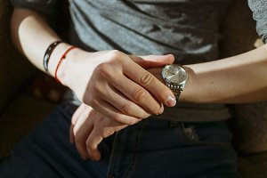 Closeup of man in casual wear look his watch