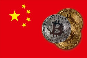 Bitcoin coins on red China flag