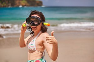 Smiling woman with snorkel mask