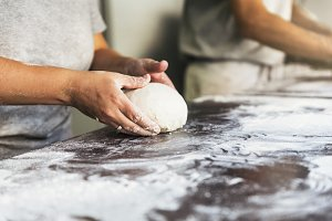 Baker preparing bread in the bakery.