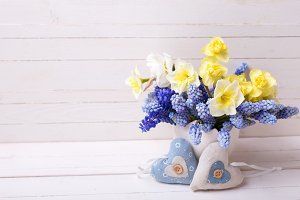 Bright spring flowers and two hearts