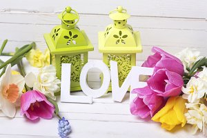 Word love and bright flowers