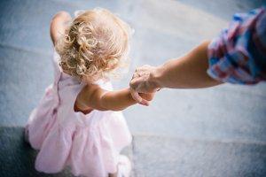 Holding little hand