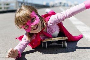 Cheerful superhero kid