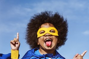 Cheerful superhero kid