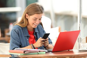 Cheerful student texting
