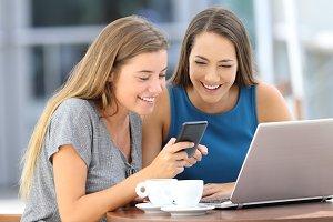 Friends sharing a smart phone