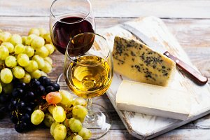 Red and white wine and assortment of cheese