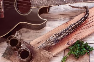 dried sturgeon, dark beer and guitar
