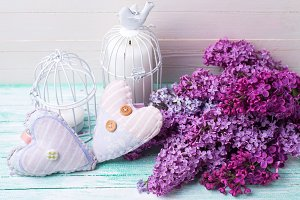 Lilac flowers, hearts, candles