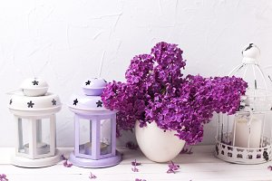 Lilac flowers, lanterns, candle