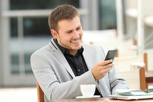 Executive man reading on line