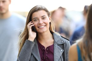 Happy lady calling on the phone