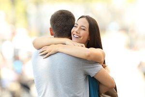 Happy girlfriend hugging