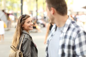 Strangers girl and guy flirting