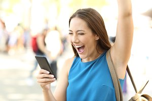 Excited woman raising arm