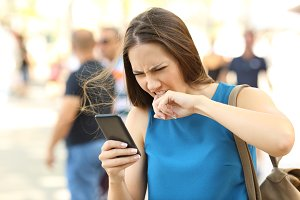 Angry woman fed up of her phone