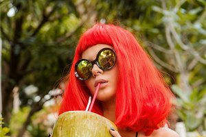 Beautiful girl drink sweet coconut.